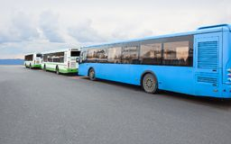 Buses in the Parking lot. Large buses in the Parking lot in a line against the sky Stock Photography