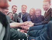 Large business team showing unity with their hands together Royalty Free Stock Photography