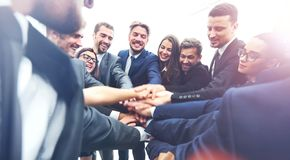 Large business team showing unity with their hands together royalty free stock image