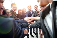 Large business team showing unity with their hands together Royalty Free Stock Images