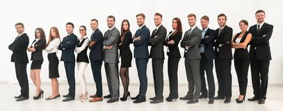 Large business team standing arms crossed in front stock photo