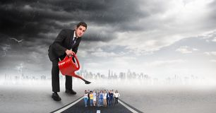 Large businessman pouring water on employees against storm clouds royalty free illustration
