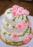 A large cake. Big beautiful delicious birthday cake with pink roses on a white background of cream Royalty Free Stock Photos