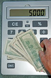 Large calculator. Calculator money and hand- you can fill in your own amount Stock Images