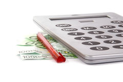 Large calculator with a red pen and the bills Stock Images