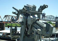 Large caliber WWII machine gun. Large .50 caliber anti-aircraft machine guns were mounted on the deck of navy military ships during WWII to protect from incoming Stock Images