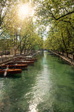 Large canal with boats and trees in the city center of historic Annecy. Located in the Haute-Savoie department, south-eastern France. Retouched photo Stock Photography