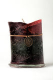 A large candle on glass base. Royalty Free Stock Photo
