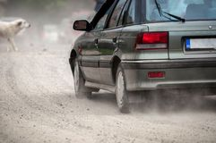 Large car in a rush. On bad dirty road Royalty Free Stock Photo