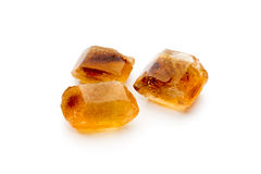 Large caramelized sugar on a white background. Royalty Free Stock Photography