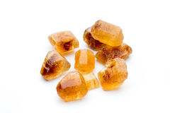 Large caramelized sugar on a white background. Stock Photos