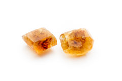 Large caramelized sugar on a white background. Royalty Free Stock Image