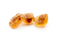 Large caramelized sugar on a white background. Stock Photography