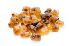 Large caramelized sugar on a white background. Stock Photo