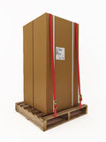 Large cardboard boxes on pellet with clipping path. The images shows a couple of cardboard boxes on a pallet and is isolated with a clipping path Royalty Free Stock Photos