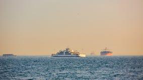 Large cargo container ship passing through Bosphorus, Istanbul, Turkey. Royalty Free Stock Photos