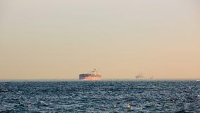 Large cargo container ship passing through Bosphorus, Istanbul, Turkey. Stock Images