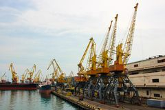 Large cargo cranes at the seaport, on the coast. royalty free stock image