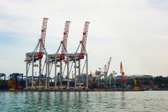 Large cargo cranes at the seaport, on the coast. stock photography