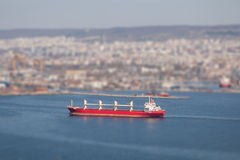 Large cargo ship arriving in port. Tilt-shift effect Stock Images