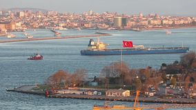Large cargo ship on the background of the Turkish flag in the Bosphorus.  stock video