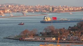 Large cargo ship on the background of the Turkish flag in the Bosphorus.  stock video footage