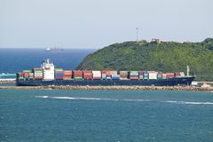 Large cargo ship bringing cargo containers to Durban, South Africa on the Indian Ocean Royalty Free Stock Photos