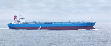 Large cargo ship floats in open ocean Royalty Free Stock Image