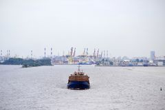 A large cargo ship floats by sea from the port of royalty free stock photography