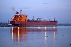 Large cargo ship in a harbor Stock Photo