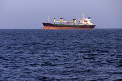 Large cargo ship on the high seas Stock Image