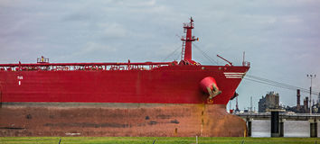 Large cargo ship parked in international port Royalty Free Stock Image
