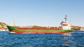 Large cargo ship proceeding along the Bosphorus Channel Royalty Free Stock Image
