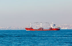 Large cargo ship proceeding along the Bosphorus Channel Royalty Free Stock Images