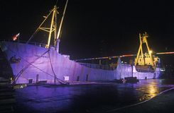 A large cargo ship, the Sao Paolo, lit up at night in a Miami, Florida harbor Stock Photography