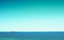 A large cargo ship at sea Stock Photography