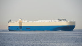 Large cargo ship at sea Stock Image