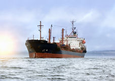 Large cargo ship at sea. Background of blue sky in the calm Royalty Free Stock Image