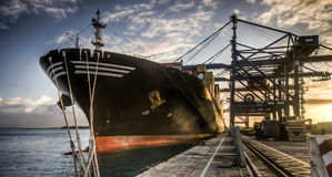 Large cargo ship transferring cargo containers in port Stock Photography