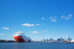 Large cargo ship in Yarra river with Melbourne CBD skyline in th Royalty Free Stock Photos