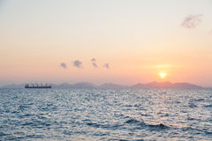 Large cargo ships and the sunrise in the morning. Stock Images