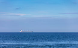 Large cargo tanker sailing across a blue sea Royalty Free Stock Photos