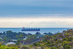Large cargo vessel sailing in Port Phillip Bay waters. Morningto Royalty Free Stock Images