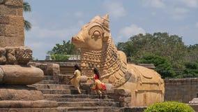 Large carving of the mythical Hindu bull Nandi. Gangaikondacholapuram, India - March 16, 2018: Sculpture of the mythical bull Nandi facing the shrine dedicated Royalty Free Stock Photos