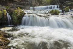 Willow River Waterfall. A large cascading waterfall in early autumn Stock Image