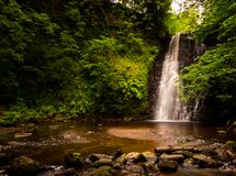 Free Large Cascading Waterfall Tumbling Into A Peaceful Pool. Falling Foss Waterfall, Yorkshire Dales Stock Image - 186078501