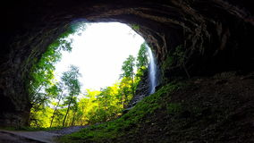 A large cave and waterfall stock footage