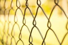 Large cells of iron mesh in the park. Large cages of iron mesh in the park. Blurred Background royalty free stock photo