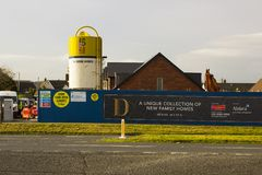 A large cement storage hopper in use on a new homes building site in Bangor County Down in Northern Ireland. This is a small site development but this storage Royalty Free Stock Photos