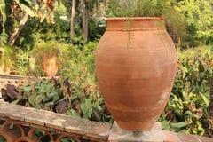 Large Ceramic Terracotta Pot in the Park. Botanical Garden of Taormina. The island of Sicily, Italy.  stock photo